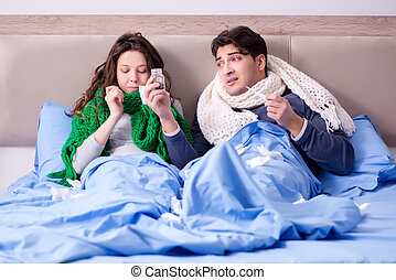 Sick wife and husband in bed in home