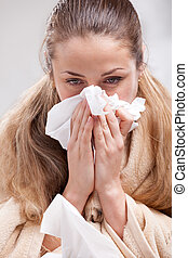 Sick woman blowing her nose - Sick yuong blonde woman...