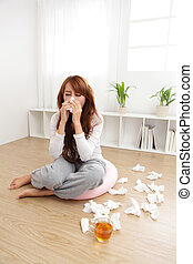 Sick Woman Caught Cold - Sick Woman sneezing into Tissue....