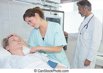 sick woman comforted by the nurse