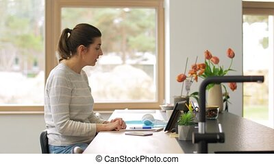 sick woman having video call on tablet pc at home