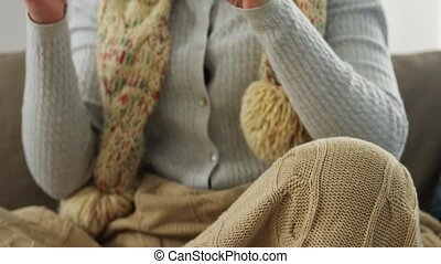 sick woman in scarf drinking cough syrup at home - people, ...