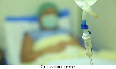 Sick woman lying in a hospital bed