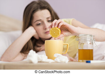 Sick woman lying in bed with high fever. She has cold and ...