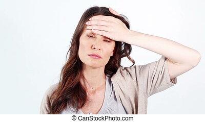 Sick woman measuring her temperature