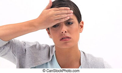 Sick woman placing her hand on her forehead