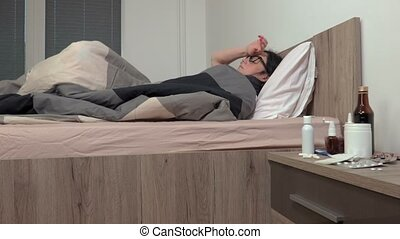 Sick woman sleeping in the bed