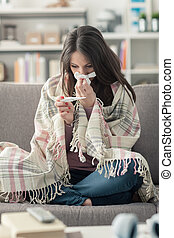 Sick woman taking temperature