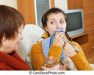 sick woman with cough using handkerchief in home