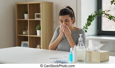 sick woman with medicine coughing to paper tissue