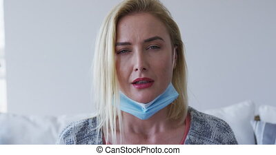 Sick woman with tissue sneezing at home