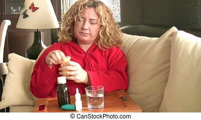 Sick women taking her pills