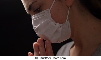 sick young woman in protective face mask praying - health ...