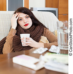 sick young woman with medications