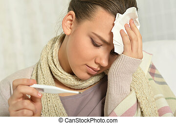 Sick  young  woman with thermometer