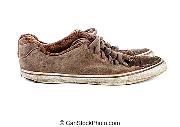 Side angle view of The old brown sneakers