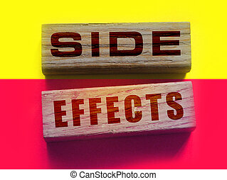 SIDE EFFECTs on wooden blocks. Pharmaceutical medical drugs Concept