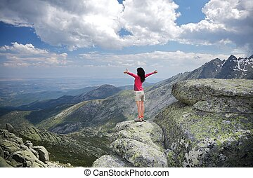 side embracing woman at the top - trekking woman at Gredos ...