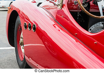 Side Exhaust Pipe Coming Out from Red Vintage Car