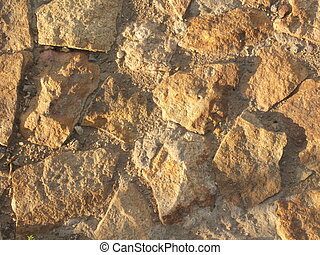 Side-lit stone wall as background - stone made of big...