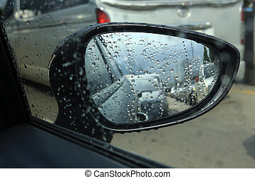 side mirror car in traffic jam and rain