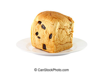 Side of bread with raisin dish on white background.