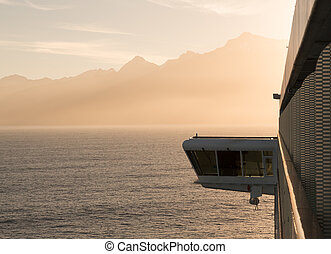 Side of cruise ship sailing to Milford Sound