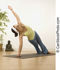 Side plank  - woman in a traditional yoga pose