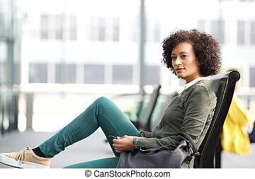 african american woman sitting on bench