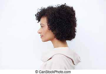 Side portrait of attractive older african american woman against white background