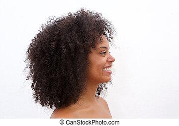 Side portrait of beautiful black woman smiling