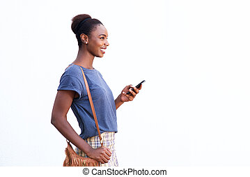 beautiful young african american woman smiling against white isolated background