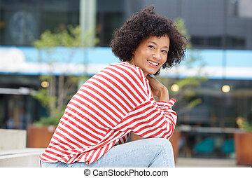happy older woman sitting outside