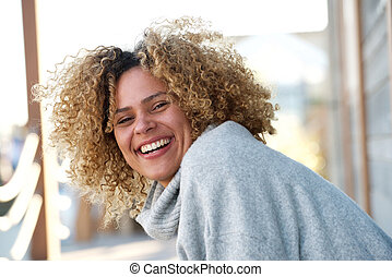 happy young african american woman laughing