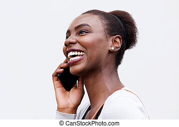 Side portrait of happy young african american woman talking on cellphone