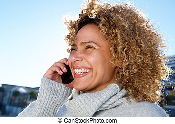 happy young african american woman talking on mobile phone