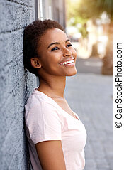 smiling young african woman smiling outside