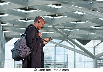traveling businessman with bag and mobile phone