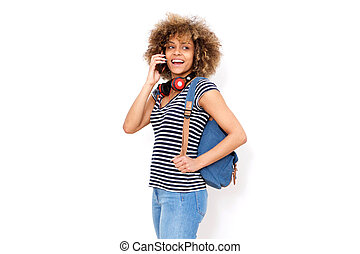 young black woman with bag talking on mobile phone
