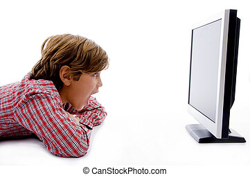 side pose of boy watching lcd screen against white...