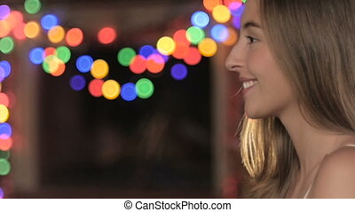 Side profile of a beautiful woman blowing confetti and...