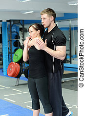 Side stretching with personal trainer