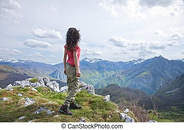 side trekking woman at Picos de Europa - woman trekking at...