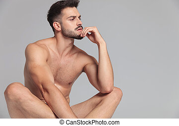side veiw of a man lying down and thinks