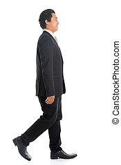Side view Asian business man walking