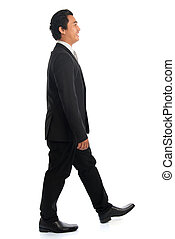 Side view Asian businessman walking
