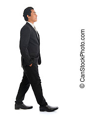 Side view Asian businesspeople walking