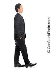 Side view Asian male walking