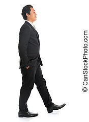 Side view Asian man walking