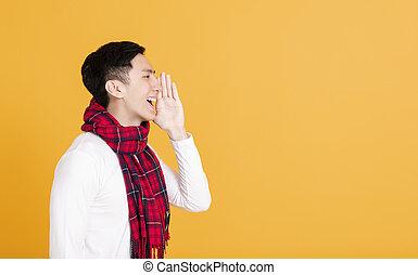 side view asian young man shouting